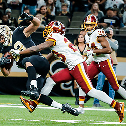 Nov 19, 2017; New Orleans, LA, USA;New Orleans Saints tight end Coby Fleener (82) catches a pass over Washington Redskins safety DeAngelo Hall (23) during the second half of a game at the Mercedes-Benz Superdome. The Saints defeated the Redskins 34-31 in overtime. Mandatory Credit: Derick E. Hingle-USA TODAY Sports