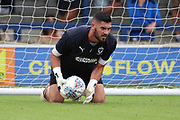 AFC Wimbledon goalkeeper Tom King (1) warming up during the EFL Sky Bet League 1 match between AFC Wimbledon and Coventry City at the Cherry Red Records Stadium, Kingston, England on 11 August 2018.