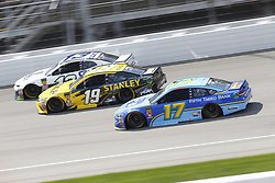 August 12, 2018 - Brooklyn, Michigan, United States of America - Ty Dillon (13), Daniel Suarez (19) and Ricky Stenhouse, Jr (17) battle for position during the Consumers Energy 400 at Michigan International Speedway in Brooklyn, Michigan. (Credit Image: © Chris Owens Asp Inc/ASP via ZUMA Wire)