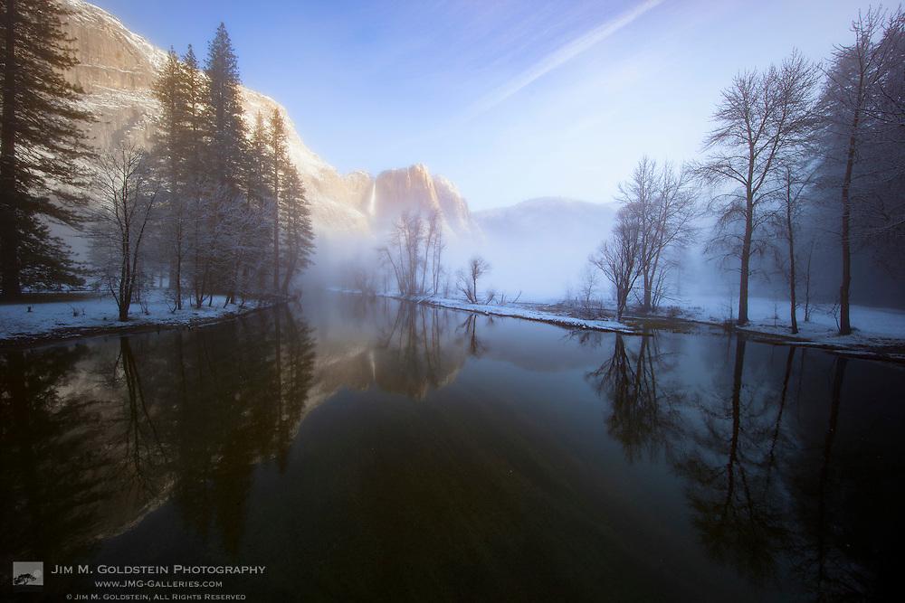 Morning light on Yosemite Falls amidst rising winter  fog - Yosemite National Park