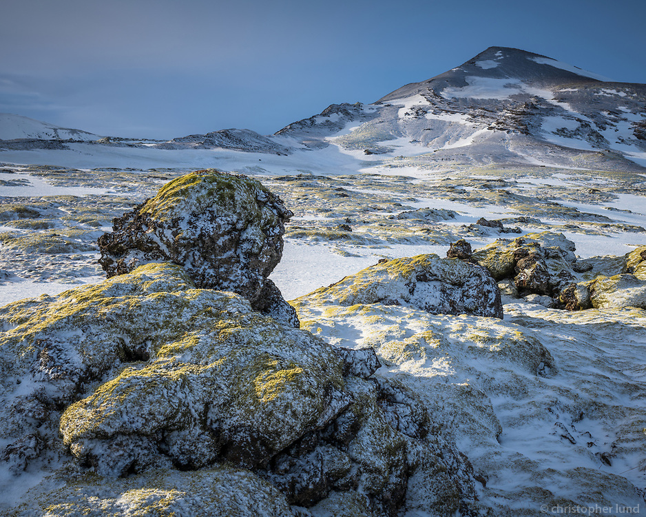 Moss and snow covered lava field at Hellisheiði Heath, South Iceland.