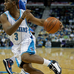 Oct 10, 2009; New Orleans, LA, USA; New Orleans Hornets drives past Oklahoma City Thunder forward Kevin Durant (35) to the basket against the Oklahoma City Thunder in the second quarter at the New Orleans Arena. Mandatory Credit: Derick E. Hingle-US PRESSWIRE