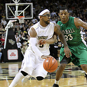 Central Florida guard Marcus Jordan (5) drives past Marshall guard Shaquille Johnson (23) during a Conference USA NCAA basketball game between the Marshall Thundering Herd and the Central Florida Knights at the UCF Arena on January 5, 2011 in Orlando, Florida. Central Florida won the game 65-58 and extended their record to 14-0.  (AP Photo/Alex Menendez)