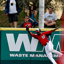 Mar 9, 2013; Melbourne, FL, USA; Washington Nationals center fielder Denard Span (2) leaps at the wall to stop a homerun on a fly ball hit by Miami Marlins designated hitter Kyle Jensen during the top of the third inning of a spring training game at Space Coast Stadium. Mandatory Credit: Derick E. Hingle-USA TODAY Sports