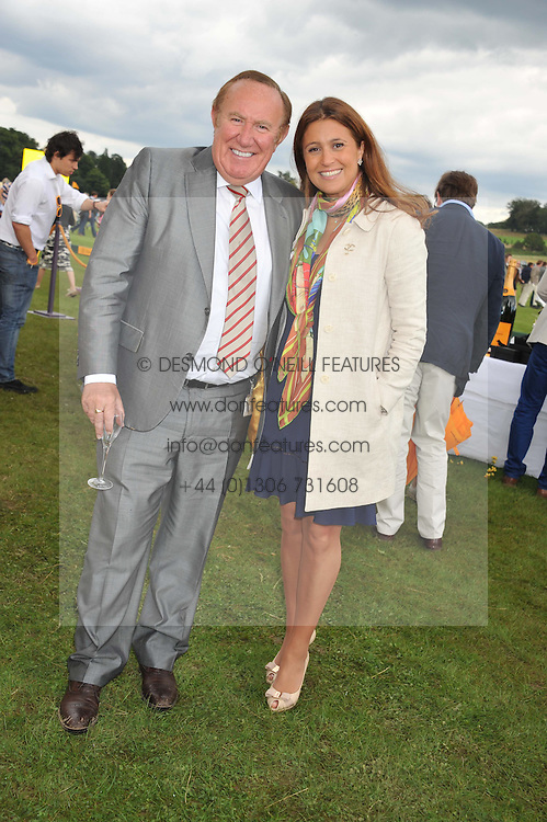 ANDREW NEIL and SUSAN NILSSON at the 2012 Veuve Clicquot Gold Cup Final at Cowdray Park, Midhurst, West Sussex on 15th July 2012.