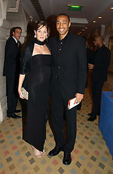 Footballer THIERRY HENRY and his wife NICOLE at a dinner hosted by footballer Patrick Vieira and the Diambars UK Charital Trust at The Landmark Hotel, 222 Marylebone Road, London NW1 on 3rd February 2005.<br /><br />NON EXCLUSIVE - WORLD RIGHTS