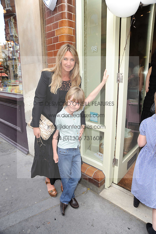 ANYA HINDMARCH and her son OTTO at Papillon Shoes Enchanted Tea Party Store Launch 98 Marylebone Lane, London W1 on 25th May 2010.