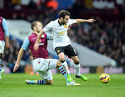 Aston Villa's Ron Vlaar tackles Manchester United's Juan Mata - Photo mandatory by-line: Joe Meredith/JMP - Mobile: 07966 386802 - 20/12/2014 - SPORT - football - Birmingham - Villa Park - Aston Villa v Manchester United - Barclays Premier League