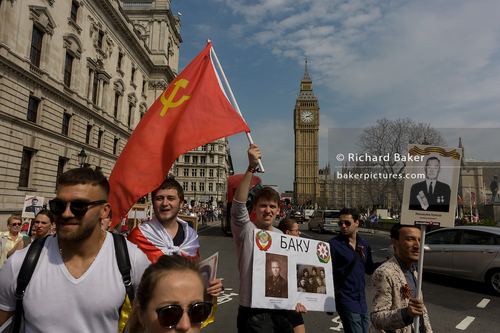 Russians living in the UK march through Westminster in central London to honour those fallen during the second world war (1939-45) 9th May, 2016. Thousands of Russian-speakers gathered in Trafalgar Square, progressing via Downing Street (the official residence of British Prime Minister David Cameron) before continuing to Parliament Square.