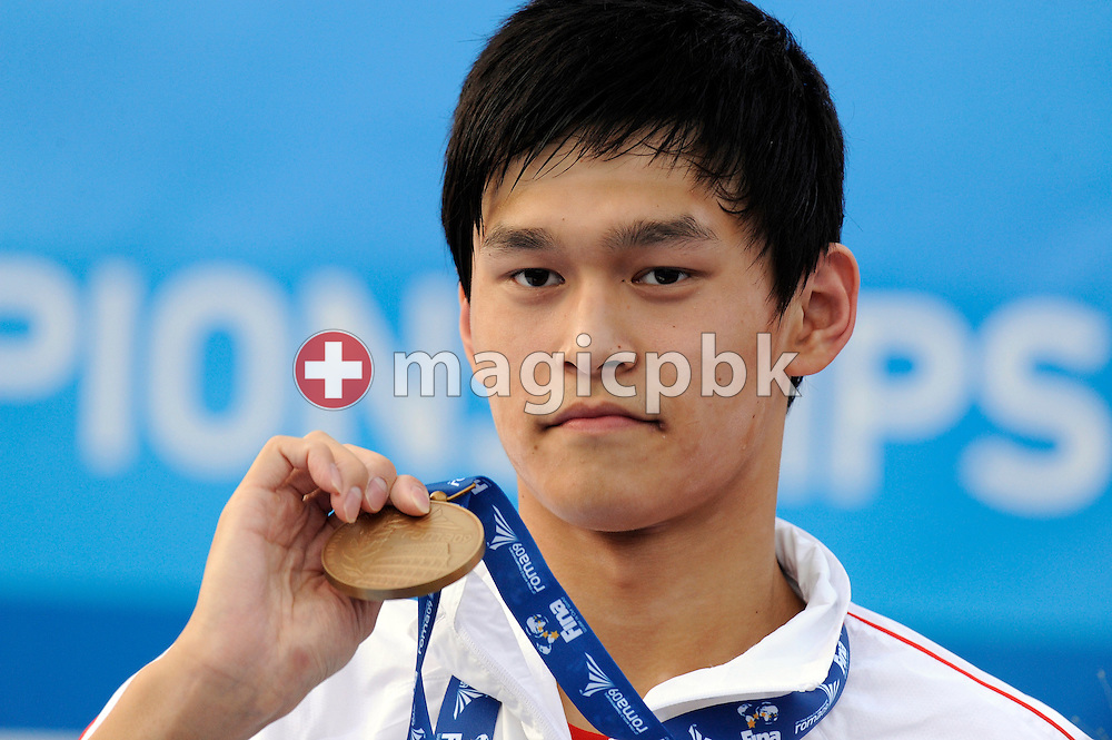 Yang SUN of China poses with his bronze medal during the award ceremony after finishing third in the men's 1500m freestyle final at the 13th FINA World Championships at the Foro Italico complex in Rome, Italy, Sunday, Aug. 2, 2009. (Photo by Patrick B. Kraemer / MAGICPBK)