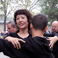 Asia, China, Beijing. Ballroom dancers in Beijing's Temple of Heaven Park.