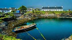 Easdale Island, the smallest permanently-inhabited island of the Inner Hebrides, Scotland.  Part of the harbour.<br /> <br /> (c) Andrew Wilson | Edinburgh Elite media