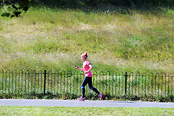 © Licensed to London News Pictures. 18/06/2015<br /> Greenwich Park jogger.<br /> Greenwich Sunny weather in South East London,UK.<br /> Early morning sunny weather in Greenwich Village and Greenwich Park today (18,06,2015)<br /> (Byline:Grant Falvey/LNP)