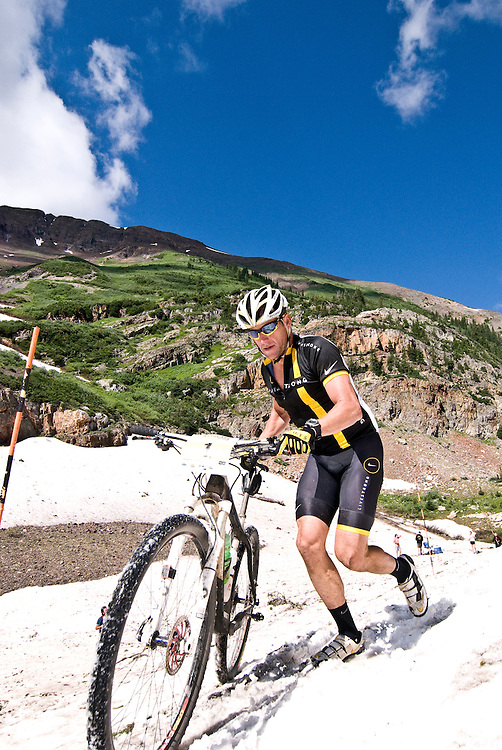 """I don't think we're in France anymore Toto."" Lance Armstrong reminds himself of the disparities between road and mountain competition as he hikes a bike through the 100yd snow plug below Emerald Lake. Racers had to cross this snowfield at 11,000ft twice during Sunday's race."