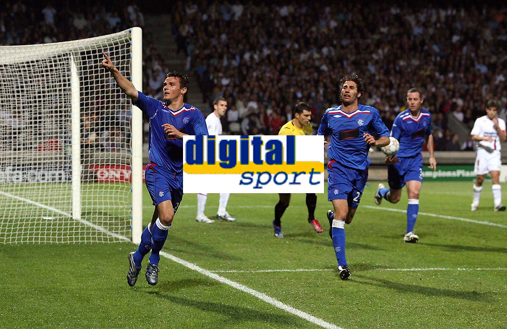 Photo: Paul Thomas.<br /> Lyon v Rangers. UEFA Champions League, Group E. 02/10/2007.<br /> <br /> Lee McCulloch (L) of Rangers celebrates his goal.