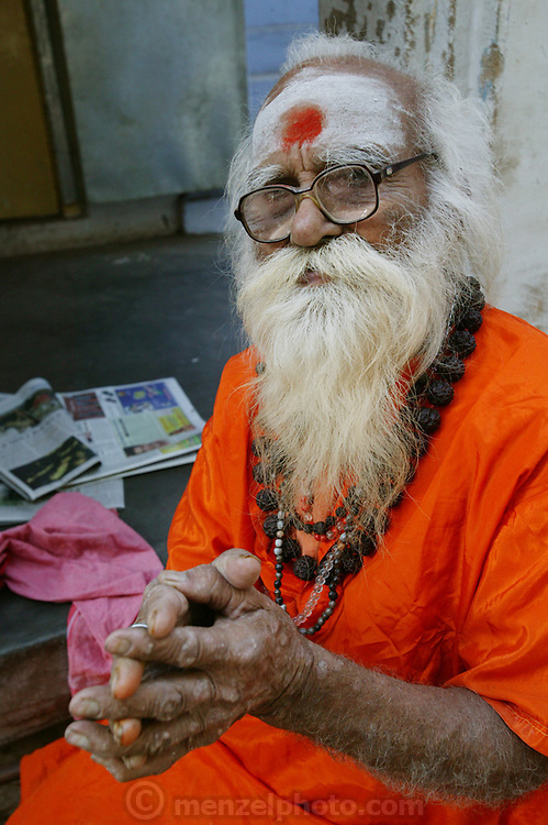 An elderly man lives on the street near the Manikarnika Ghat, in Varanasi, India.