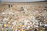 TAICANG, CHINA - DECEMBER 23: <br /> <br /> Transport Ships Illegally Dump Waste Into Yangtze River<br /> <br /> Workers clear rubbish in Taicang reach of Yangtze River on December 23, 2016 in Taicang, Jiangsu Province of China. About a hundred workers were sent to clear rubbish on the shore of China\'s Taicang reach of Yangtze River. A large amount of waste, mostly domestic waste, floated on the Taicang reach of Yangtze River as a form of water pollution. According to preliminary investigation, transport ships from Haiyan County illegally dumped over 2000 tons domestic waste<br /> ©Exclusivepix Media