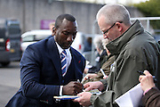 Queens Park Rangers Manager Jimmy Floyd Hasselbaink  signing autographs during the Sky Bet Championship match between Burnley and Queens Park Rangers at Turf Moor, Burnley, England on 2 May 2016. Photo by Simon Davies.