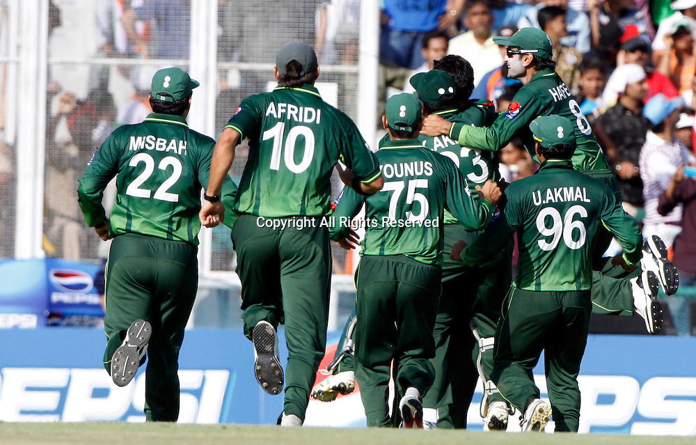 30.03.2011 Cricket World Cup from the Punjab Cricket Association Stadium, Mohali in Chandigarh. India v Pakistan. Players of Pakistan celebrates the wicket of Indian Captain Mahendra Singh Dhoni during the match of the ICC Cricket World Cup between India and Pakistan.