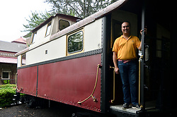 Mayor Peter Ursucheler stands on the back of a stationary caboose, located at the former train station in Phoenixville, PA, on august 21, 2018. The Colombia Station currently houses an event venue.
