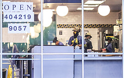 Waffle House employees opened the dining room on Monday, April 27, 2020 at the Waffle House in Atlanta. Restaurants around metro Atlanta began to reopen dining rooms Monday, April 27, 2020 as restrictions related to the coronavirus pandemic are lifted. Restaurants will be allowed to operate with in-person dining as long as they follow a set of 39 guidelines laid out by the state government, which include a requirement that all employees wear masks, a maximum of 10 customers per 500 square feet of floor space and a maximum of six diners per table. Photo by John Spink/Atlanta Journal-Constitution/TNS/ABACAPRESS.COM