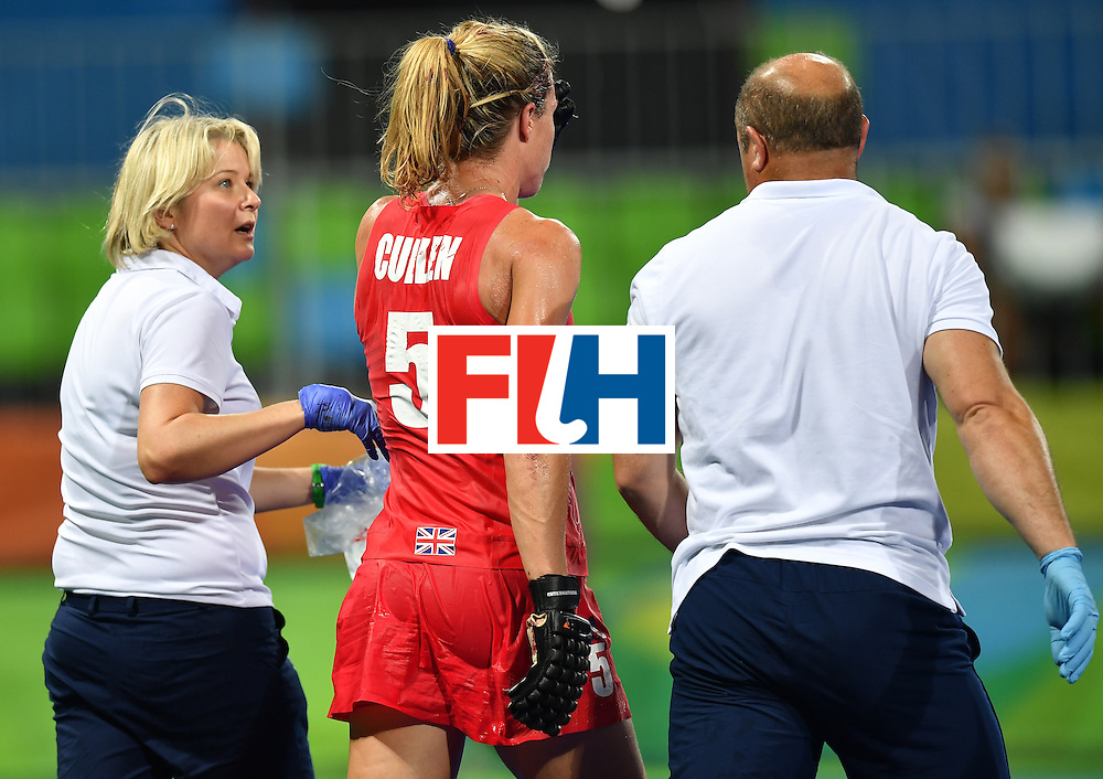 Britain's Crista Cullen (L) leaves the field after resulting injuried during the women's semifinal field hockey New Zealand vs Britain match of the Rio 2016 Olympics Games at the Olympic Hockey Centre in Rio de Janeiro on August 17, 2016. / AFP / MANAN VATSYAYANA        (Photo credit should read MANAN VATSYAYANA/AFP/Getty Images)