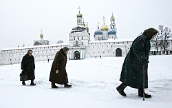Three elderly women pass by the Troitse-Sergiyev monastery, the spiritual Russian Orthodox center in Sergiyev Posad, 70km from Moscow, Russia, 30 November 2007.