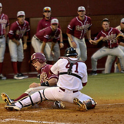 June 04, 2011; Tallahassee, FL, USA; Florida State Seminoles right fielder James Ramsey (23) slides in past Alabama Crimson Tide catcher Brock Bennett (41) during the third inning of the Tallahassee regional of the 2011 NCAA baseball tournament at Dick Howser Stadium. Mandatory Credit: Derick E. Hingle