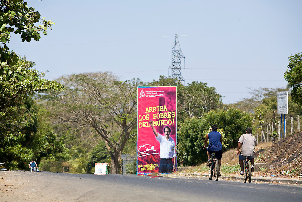 "Cycling to work past one of the billboards that have been erected all over the Nicaraguan countryside. Masatepe is close to Granada in Nicaragua. It is famous for it artisans who make furniture and most specifically, the famous rattan chairs found outside many nicaraguan homes. It is one of the ""Los Peublos Blancos"" or the white towns that sit on the central plateau."