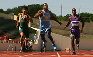 Photo by Alex Jones..McAllen Memorial's Bradley Stephens crosses the finish of the 200 meter dash with competitors on Saturday at the UIL regional track and field championships at Alamo Stadium in San Antonio.