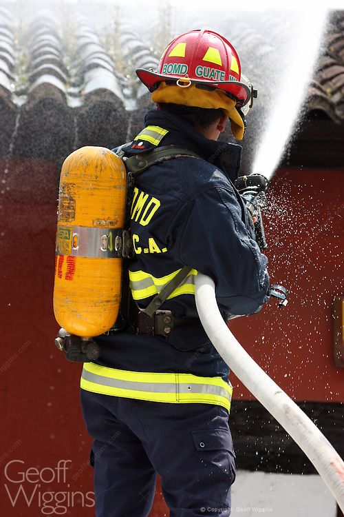 Guatemalan fire fighter with breathing apparatus tackles blaze following gas explosion in thehistoric city of Antigua, Guatemala