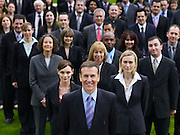 Large group of business people standing on lawn portrait elevated view