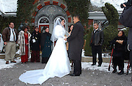 "NEW YORK, NY.   Bride Jennifer Stesanki and groom Al Villarante during their wedding ceremony at Tavern on the Green in Central Park, NY on Tuesday, December 28, 2004.  Quote from the groom's brother, Ariel: ""Wishing them lifelong memories and success. To enjoy their lives together and to make it all last.""  (Photograph by Chet Gordon for The New York Daily News)"