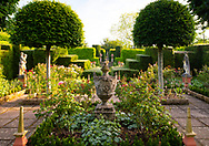 A stone urn and topiary in the Rose Garden at the Laskett Gardens, Much Birch, Herefordshire, UK