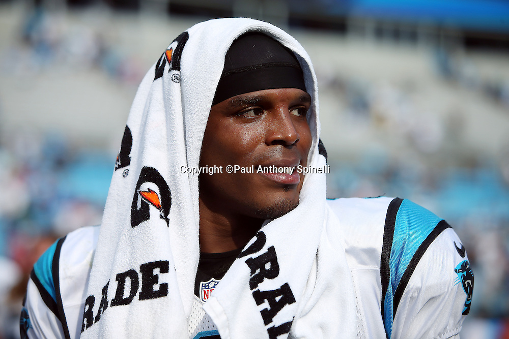 Carolina Panthers quarterback Cam Newton (1) wears a towel over this head after the 2015 NFL week 2 regular season football game against the Houston Texans on Sunday, Sept. 20, 2015 in Charlotte, N.C. The Panthers won the game 24-17. (©Paul Anthony Spinelli)