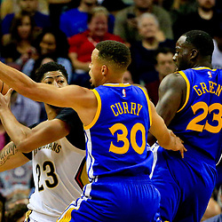 Oct 28, 2016; New Orleans, LA, USA;  Golden State Warriors guard Stephen Curry (30) and forward Draymond Green (23) defend New Orleans Pelicans forward Anthony Davis (23) during the first quarter of a game at the Smoothie King Center. Mandatory Credit: Derick E. Hingle-USA TODAY Sports