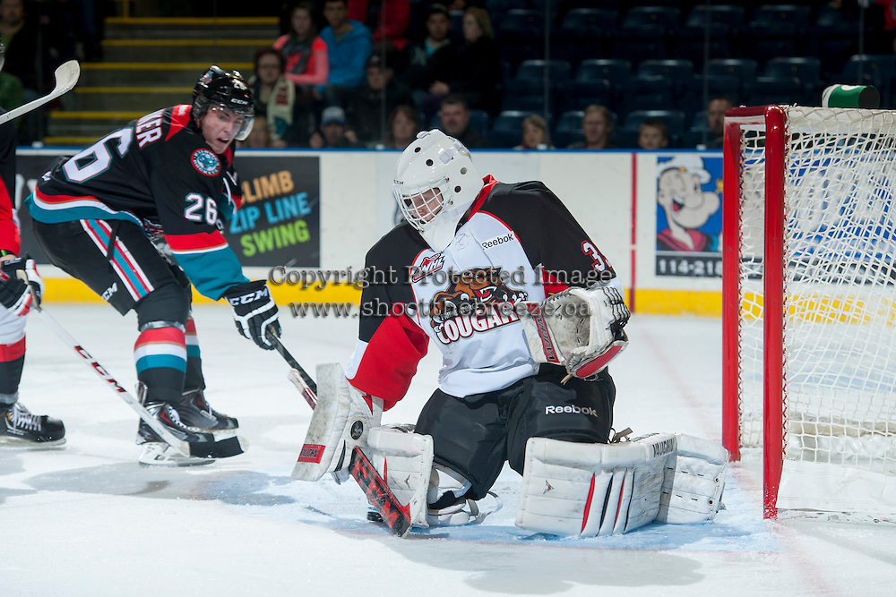 KELOWNA, CANADA - OCTOBER 19: Ty Edmonds #35 of the Prince George Cougars defends the net against the Kelowna Rockets on October 19, 2013 at Prospera Place in Kelowna, British Columbia, Canada.   (Photo by Marissa Baecker/Shoot the Breeze)  ***  Local Caption  ***