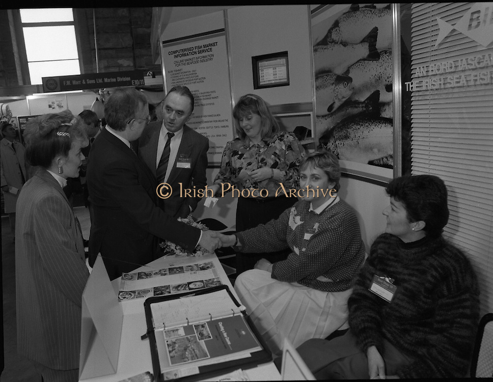 The 1989 Boat Show.   (R89)..1989..10.03.1989..03.10.1989..10th March 1989..Pat the Cope GallagherTD, Minister for the Marine attended the opening of the 1989 Boat Show held at the Point Depot, Dublin. The opening coincided with the minister's birthday...Image shows the Minister taking the time to meet the staff manning the Bord Iascaigh Mhara  display stand at the Boat Show.