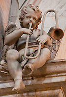 Sculpture of a cherub playing a trombone in the cathedral in Lugano, Ticino, Switzerland.