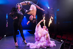 "© Licensed to London News Pictures. 24/04/2019. LONDON, UK. (L to R) Bernie Dieter, Beau Sargent (aerial contortionist) and Kitty Bang Bang (fire breathing bearded lady) at the preview of Bernie Dieter's ""Little Death Club"" an eclectic performance show taking place at the Underbelly Festival on the Southbank until 23 June 2019.  Photo credit: Stephen Chung/LNP"