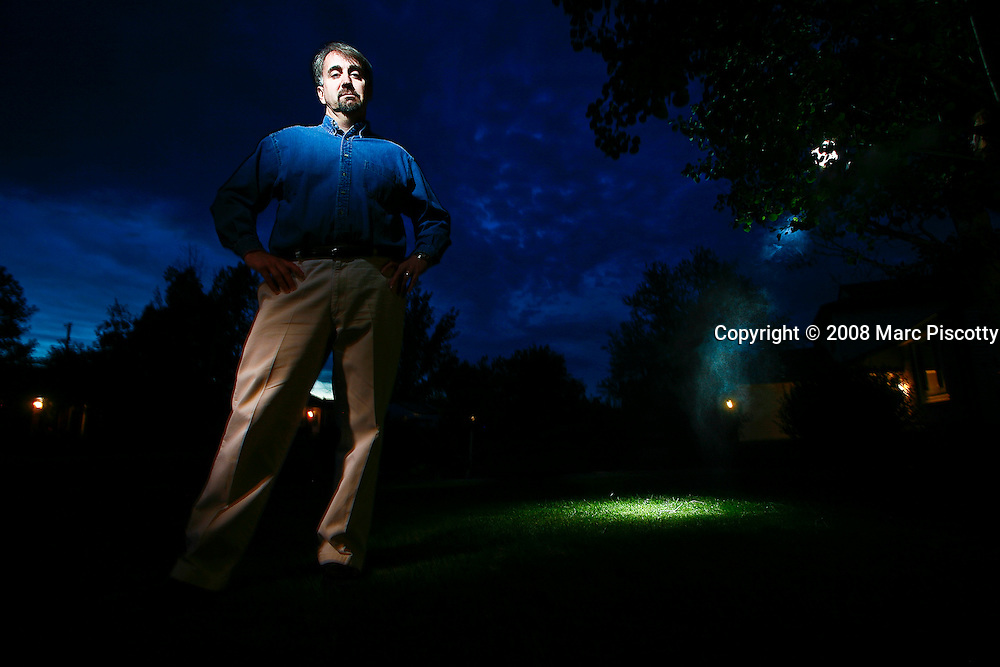 "SHOT 5/23/08 8:49:41 PM - Portraits of Stan Romanek, 45, of Loveland, Co. who claims to have experienced and even documented more than 100 extraterrestrial encounters in his lifetime. Since December 2000 Romanek said he has been abducted numerous times and been the conduit for complex mathematical equations that he doesn't even understand. Romanek said he understands that there are skeptics out there and added, ""I'm not the only one to go through this and most people don't want to talk about it because of the ridicule, I just want to be taken seriously"". He has attempted to use mainstream science to study the experiences and a non-fiction book and documentary are in the works about his life. .(Photo by Marc Piscotty / © 2008)"