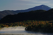 View of Whiteface Mountain from Mirror Lake in Lake Placid, N.Y. with mist rising from the water. (Photo/Todd Bissonette - www.rtbphoto.com)