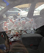 EVER been too busy to give the car a proper clean and ended up with a back seat full of rubbish?<br /> <br /> Well spare a thought for these hapless souls who don't seem to have EVER given their motor a tidy.<br /> <br /> these snaps of junk-filled autos from around the world, and some of them look more like skips. It is hard to imagine how the owners even manage to get into some of these rolling dustbins, as they appear to be filled to bursting point with newspapers and other junk.<br /> Lets just hope they never have to give their mates a lift to the shops.<br /> ©Exclusivepix Media
