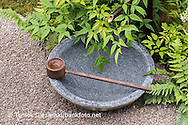 Bamboo water feature with stone bowl