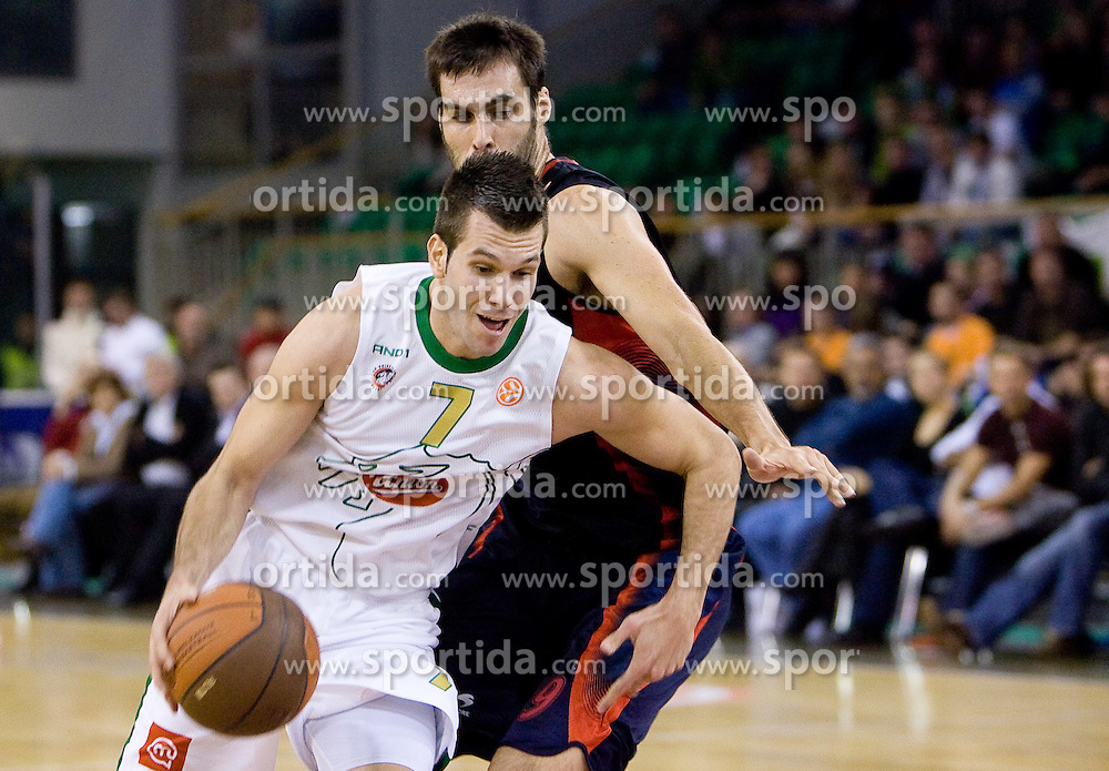 Sani Becirovic (7) of Olimpija vs Fernando San Emeterio of Caja Laboral Baskonia  at Group C of Euroleague basketball match between KK Union Olimpija, Slovenia and Caja Laboral, Spain, on November 5, 2009, in Arena Tivoli, Ljubljana, Slovenia.  (Photo by Vid Ponikvar / Sportida)