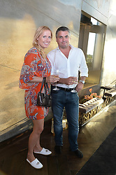 An exclusive preview of the new Samsung OLED Curved TV has hosted by Nick & Holly Candy at their home at One Hyde Park, London on 29th August 2013.<br /> Picture shows:- Katherine Cowell and Guy Winterflood.