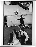 Sliding down the marquee during the New College May Ball. Oxford. 24 June 1983. film 83445f6<br /> &copy; Copyright Photograph by Dafydd Jones<br /> 66 Stockwell Park Rd. London SW9 0DA<br /> Tel 0171 733 0108