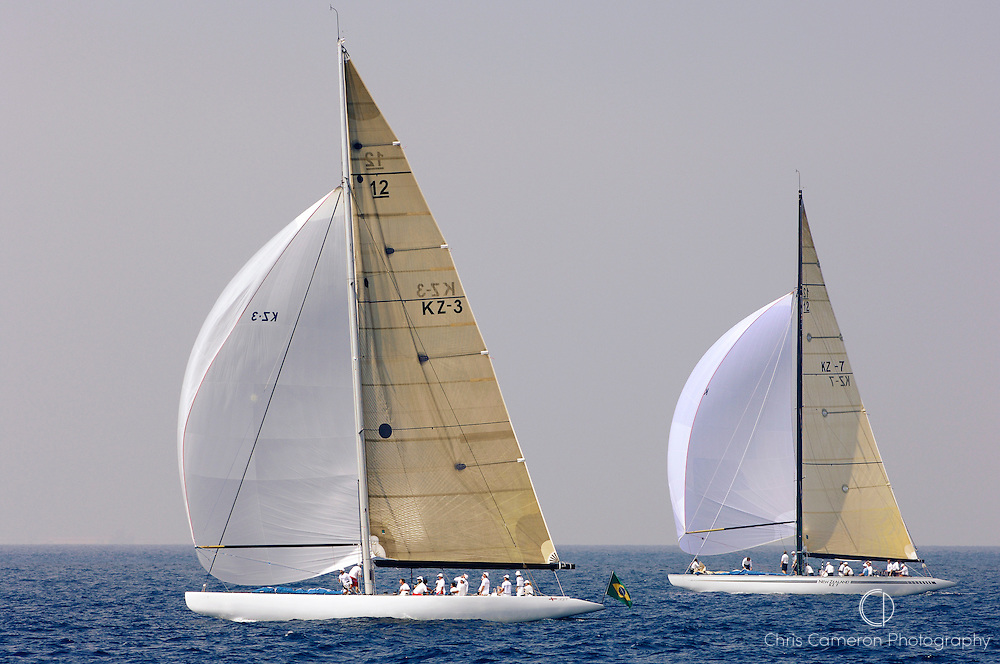 12 metre race yacht KZ7 and KZ3 (New Zealand) under spinnaker power sailing downwind in apractice session before the 12 metre regatta in Valencia, Spain