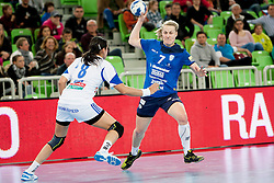 Cristina Georgiana #8 of ZRK Buducnost and Nina Christin Worz #7 of RK Krim Mercator during handball match between RK Krim Mercator (SLO) and ZRK Buducnost (MNE) in 6th Round of Main Round of Women's EHF Champions League 2013/14  on March 15, 2014 in SRC Stozice, Ljubljana, Slovenia. Photo by Urban Urbanc / Sportida.com