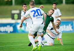 Enes Rujovic #21 of Krsko falling by Jure Travner #16 of Celje during football match between NK Krsko and NK Celje in 1st Round of Prva liga Telekom Slovenije 2015/16, on July 19, 2015 in Stadium Matije Gubca, Krsko, Slovenia. Photo by Vid Ponikvar / Sportida